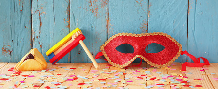 haman: website banner background of Purim celebration concept jewish carnival holiday. selective focus. vintage filtered