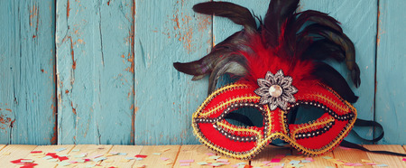 party night: website banner background of colorful Venetian masquerade mask. selective focus. vintage filtered Stock Photo