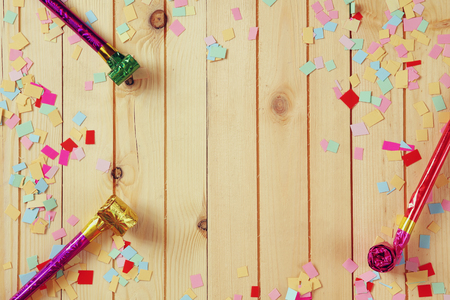 party table: party background with colorful confetti and party whistle