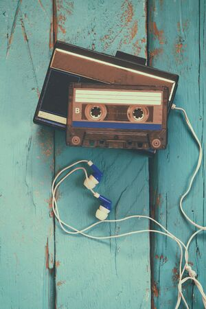 tape player: Cassette and old tape player over wooden background. retro filter Stock Photo