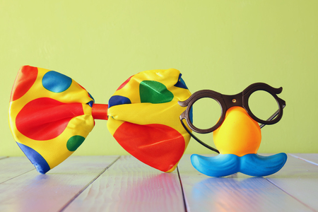 fanny: fanny glasses and mustache mask on wooden table. retro filtered Stock Photo