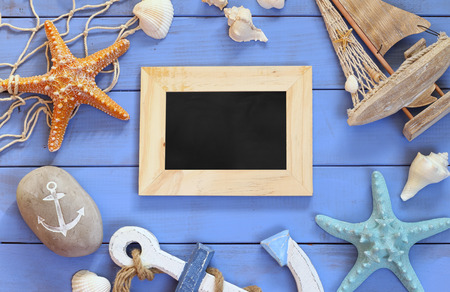 the next life: top view of nautical concept with blank chalkboard next to nautical life style objects Stock Photo