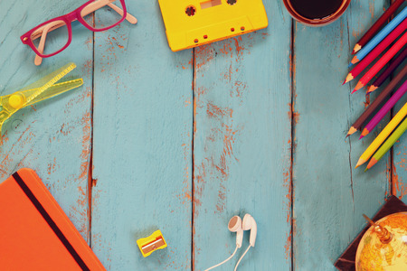 top view image of school supplies on wooden table. vintage filtered. education concept