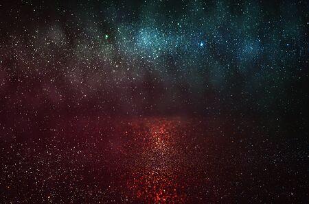 red and black: glitter vintage lights background. gold, red, blue and black. defocused.