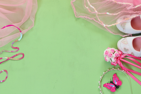 party outfit: top view of Small girls party outfit: white shoes, crown and wand flowers. bridesmaid or fairy costume