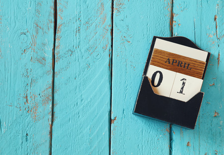 image of April First wooden vintage calendar on white background 스톡 콘텐츠