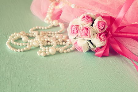 party outfit: Small girls party outfit: crown and wand flowers on wooden table. bridesmaid or fairy costume. vintage filtered