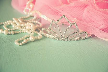 feminine background: Wedding vintage crown of bride, pearls and pink veil. wedding concept. vintage filtered. selective focus. vintage filtered