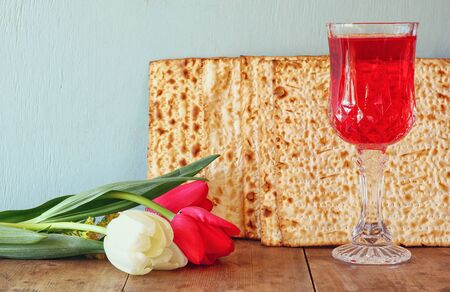 matzoth: Pesah celebration concept (jewish Passover holiday) with wine and traditional plate