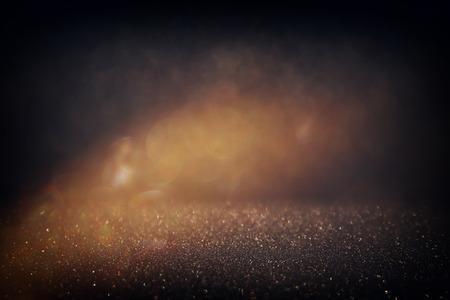 キラキラ ビンテージ ライト background.gold と黒。デフォーカス。