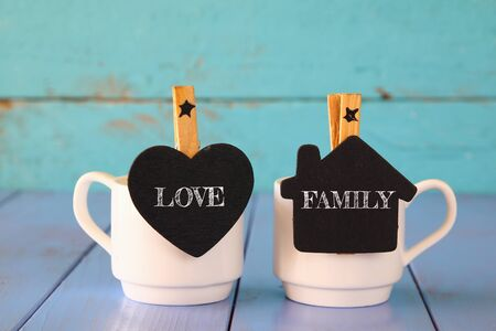 declaration of love: couple of cups of coffee and little chalkboards with the words: LOVE, FAMILY.