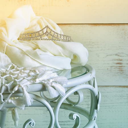 neckless: image of diamond tiara on vintage table. vintage filtered. selective focus Stock Photo
