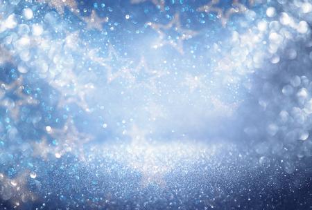 stary: glitter vintage lights background. blue, silver and black. defocused.
