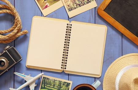 old notebook: traveling concept. vintage filtered. top view Stock Photo