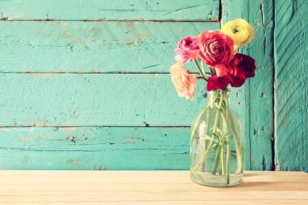 photo of spring flowers on wooden background. vintage filtered. Stock Photo