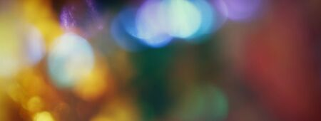 winter holiday: bokeh lights background with multi layers and colors.