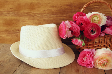 beautiful flowers: image of beautiful flowers next to fedora hat. vintage filtered. Stock Photo