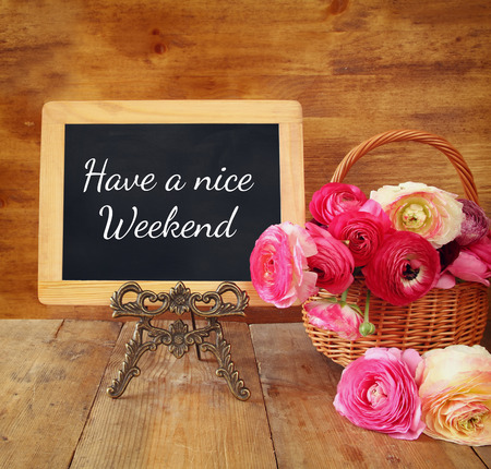 weekend activities: blackboard with the phrase have a nice weekend. Stock Photo