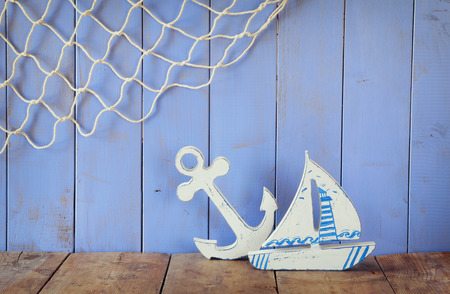 nautic: nautical life style objects on wooden table. vintage filtered