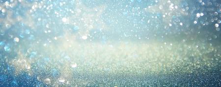 stary: glitter vintage lights background. blue, silver. defocused.