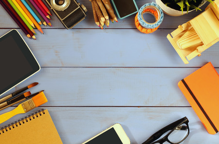 business supplies: top view photo of business and school supplies on wooden table. vintage filtered Stock Photo
