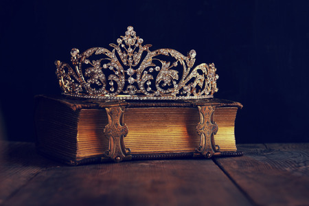 once: low key image of beautiful diamond queen crown on old book. vintage filtered. selective focus Stock Photo