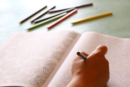 stress relief: adult coloring book trend, for stress relief. top view. selective focus