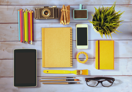 business supplies: top view photo school and business supplies on wooden table. vintage filtered Stock Photo