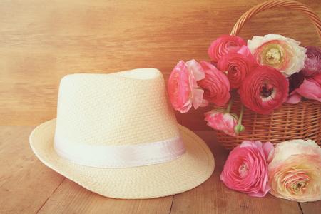 fedora: image of beautiful flowers next to fedora hat. vintage filtered