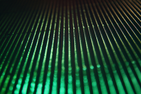 green background: metallic glitter vintage lights background. green and black. defocused.