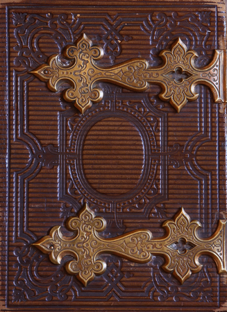 top view of antique book cover, with brass clasps. vintage filtered