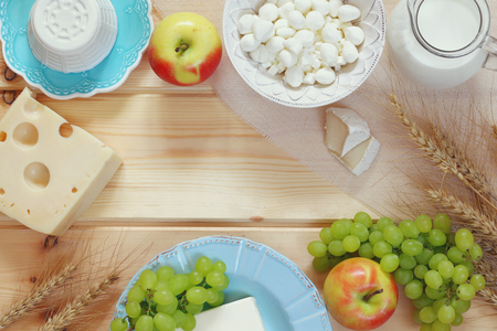 image of dairy products and fruits on wooden table.