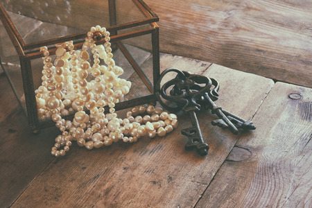 neckless: image of white pearls necklace on old grunge wooden table. vintage filtered and toned Stock Photo