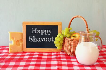 shavuot: image of dairy products and fruits on wooden table. Symbols of jewish holiday - Shavuot