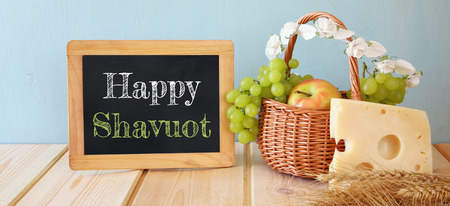 wide format image of dairy products and fruits on wooden background. Symbols of jewish holiday - Shavuot
