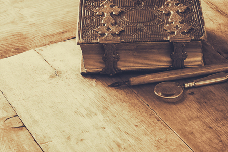 clasps: top view of antique book cover, with brass clasps. sepia vintage filtered and toned