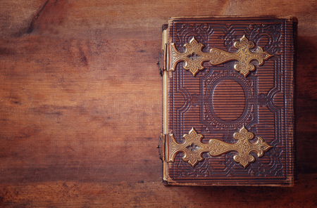 once: top view of antique book cover, with brass clasps. vintage filtered and toned