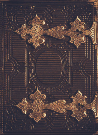 clasps: top view of antique book cover, with brass clasps. sepia vintage filtered