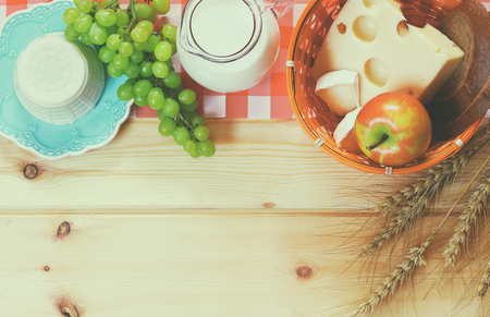 image of dairy products and fruits on wooden background.