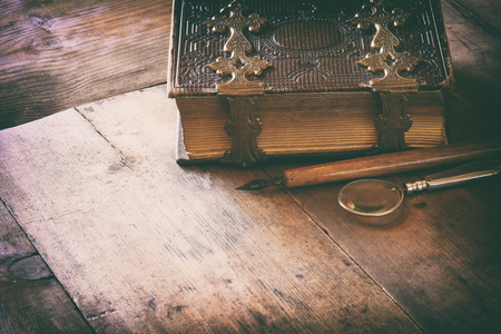 clasps: top view of antique book cover, with brass clasps. vintage filtered and toned