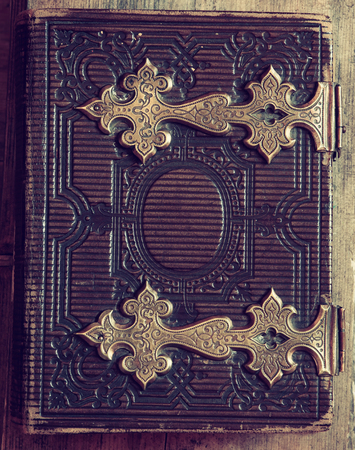clasps: top view of antique book cover, with brass clasps. vintage filtered
