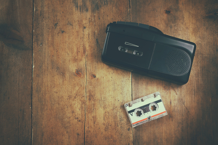 tape recorder: top view image of investigation concept. tape recorder and cassete. vintage filtered and toned