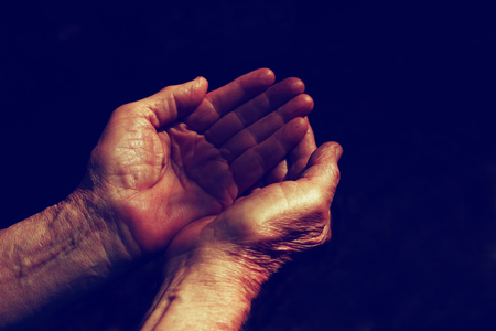 old hand: male Wrinkled old hands begging asking for money, help, reaching out and compassion concept