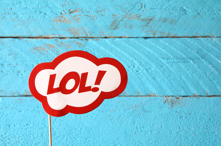 lol: LOL bubble text comic retro sign, in front of wooden background Stock Photo