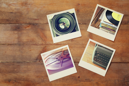 top view of instant photos album on wooden background. vintage filtered image Stock Photo