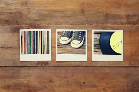 bovenaanzicht van instant foto's album op houten achtergrond. vintage gefilterd