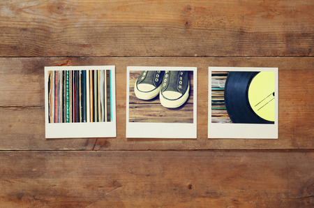 sixties: top view of instant photos album on wooden background. vintage filtered