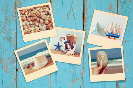 wood board: top view of instant photos album on wooden blue background. vintage filtered image Stock Photo