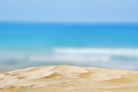sunny beach: Empty sand beach in front of summer sea background with copy space. ready to product display