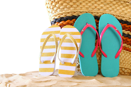 Image of tropical sandy beach, straw bag and and flip flops. Summer concept. isolated on white Stock Photo